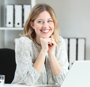 Smiling woman at a computer